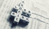 dices-over-newspaper-2656028_1280-1-e1613633987550.jpg